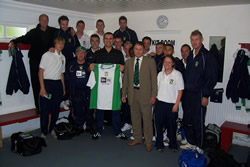 New Era CEO Peter Lee is presented with a personalised Aylesbury United shirt