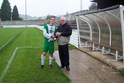 Liam Smyth receives his man of the match award